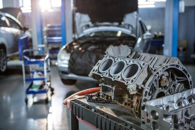 car-parts-in-repair-garage_1170-1702